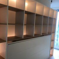 Garderobe kast met achterliggend verlichting  maatwerk meubel met uitklapbed voor logees
